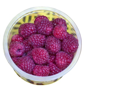 Fragrant delicious red raspberry fruits in plate