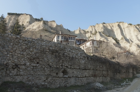 Old bulgarian town Melnik with traditional houses and pyramid loose rocks