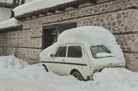 snowdrift:  Snow-drift cover front door and car in winter at Bansko, Bulgaria