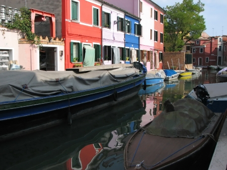 Colourful houses and boats in Burano, Venice, Italy