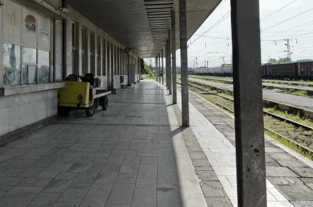 Old station of railway and view in perspective photo