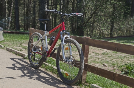 montane: A red bicycle on the montane alley