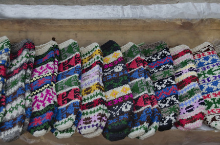 Traditional bulgarian colorfull wool stocking knitted by hand photo