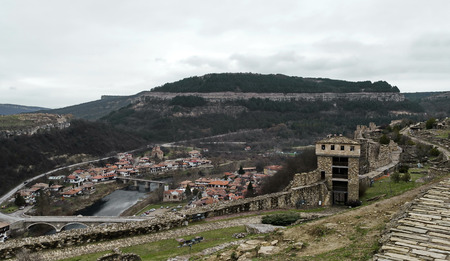 Landscape with ruin and houses in Veliko Tarnovo, Bulgaria  Stock Photo