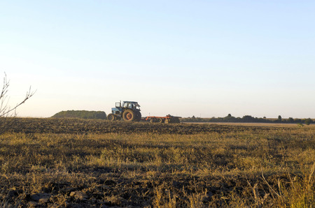 residue: Tractor cultivating wheat stubble field with crop residue, Ludogorie, Bulgaria