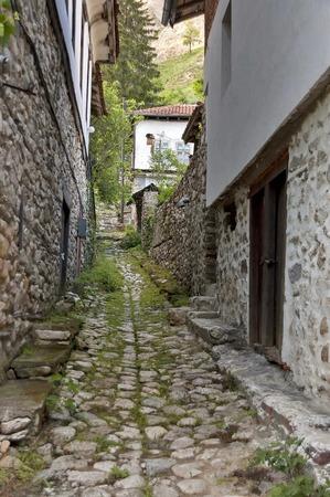 Narrow street in ancient Melnik town, Bulgaria Stock Photo