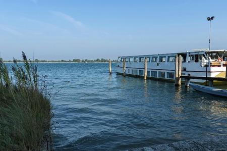 Pontoon and cruise ship anchored in the Venetian lagoon,  Adreatic sea, Italy, Europe Stock Photo