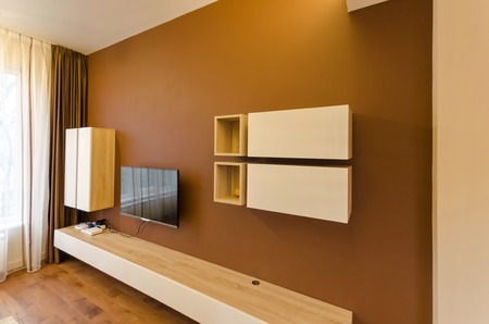 tv set: Wall in living room with cupboard and TV set Stock Photo