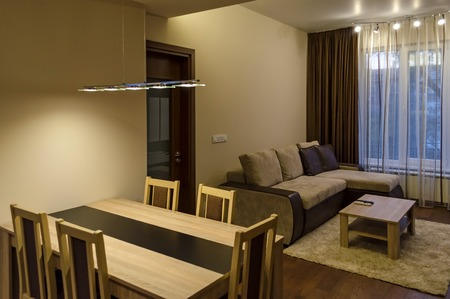 renovated: Living room  dining-table in renovated apartment with modern LED lighting, Sofia, Bulgaria Stock Photo