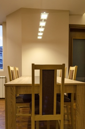 renovated: Dining-table in living room - renovated apartment in Sofia, Bulgaria Stock Photo