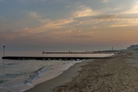 lido: Sunset at beach of Lido di Jesolo venetian Riviera Italy Stock Photo