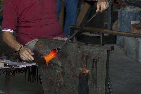 murano: Glasswork artisan make glass horse in Murano island, Italy