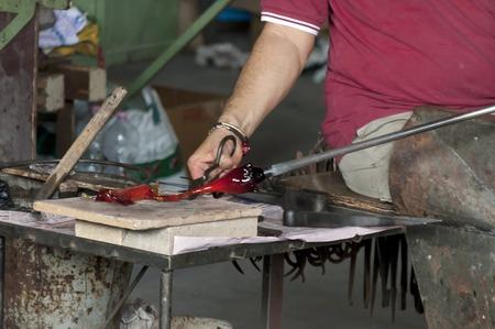 glasswork: Glasswork artisan make glass horse in Murano island, Italy
