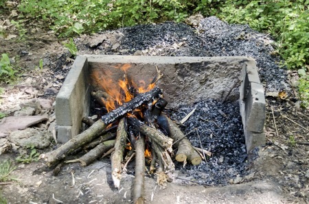 Open fire in the fireplace, prepare coal for  barbeque grill Stock Photo