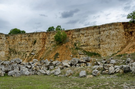 the crag: General view toward crag of sedimentary rock in the field, Ludogorie, Bulgaria