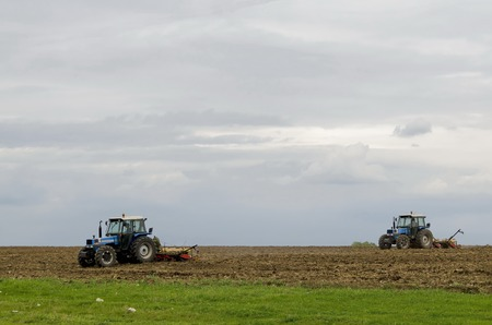 sow: Two wheeled tractors sow a field of wheat, Ludogorie, Bulgaria