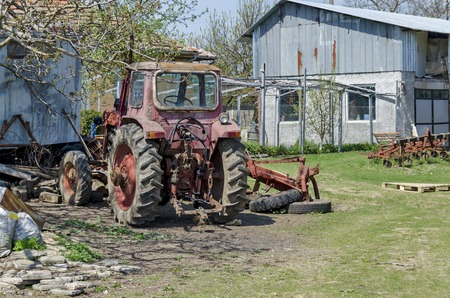 farm machinery: Old abandoned farm machinery,  tractor, old, drill, drill-plough, Bulgaria Stock Photo