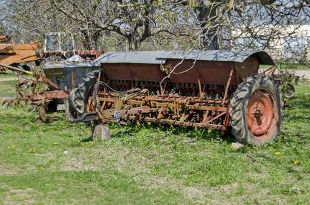 farm machinery: Old abandoned farm machinery, drill, plough,  Bulgaria Stock Photo