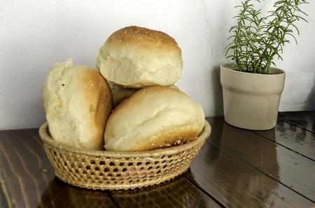 breadbasket: Small  loaf fresh household bread in the breadbasket, Sofia, Bulgaria Stock Photo