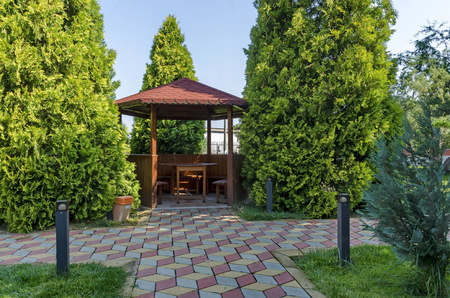 fence: Beauty green yard with alcove with table wooden and bench for rest, Septemvri town, Pazardzhik, Bulgaria