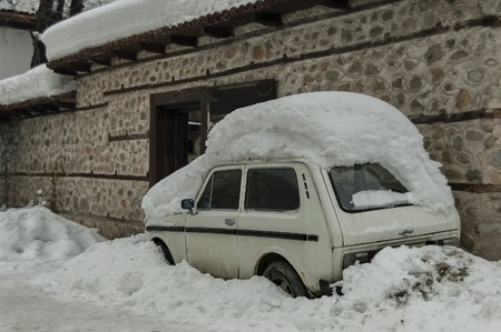 snow drift: Snow-drift cover front door and car in winter at Bansko, Bulgaria.