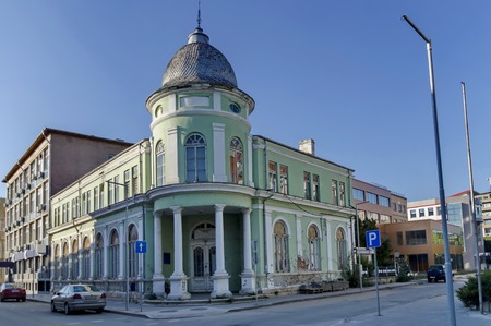corner of house: Razgrad town, street and house. Old corner house with tower, Bulgaria Stock Photo