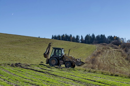 wheeled tractor: Wheeled tractor with crane and scoop  go for a worg, Plana mountain, Bulgaria
