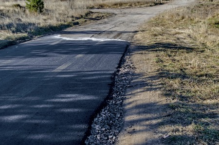 blacktop: Repaired asphalt road in the Plana mountain, Bulgaria
