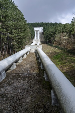 accumulating: Water pipeline transporting water down to a valley accumulation station, Pancharevo, Bulgaria
