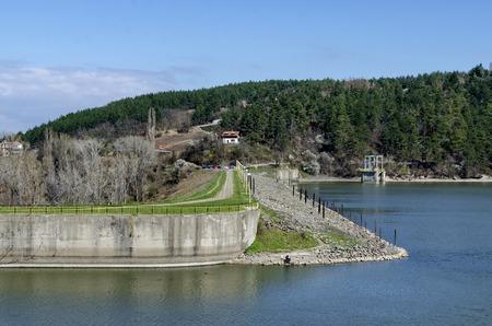 gather: Look toward barrage wall of picturesque  dam, gather water of Iskar river, Pancharevo, Bulgaria