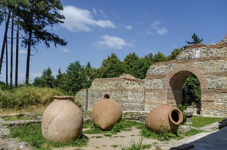 restored: View to restored inside park of  castle Hisarlak with earthen  vessel, near by Kyustendil town, Bulgaria