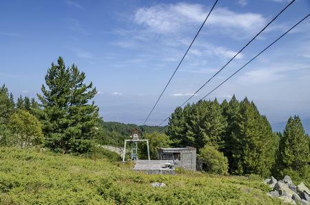 station ski: Station  of  old ski tow or lift  in sunny day with blue sky toward  Cherni vrah peak, Vitosha Mountain, Bulgaria