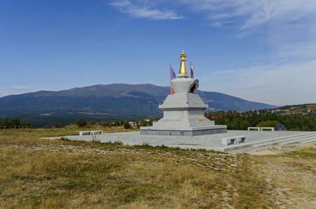 View of  Buddhist stupa Sofia in the Retreat Center Plana - Diamondway Buddhism Bulgaria near by Vitosha, Rila, Pirin, and Balkan mountains  from  distance Editorial