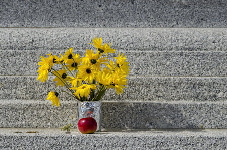 Bouquet of yellow flower Sunflower plant or Heliopsis helianthoides and apple on the stupa Sofia, Bulgaria
