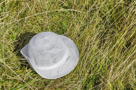 White hat abandon in the glade, Vitosha mountain, Bulgaria Stock Photo