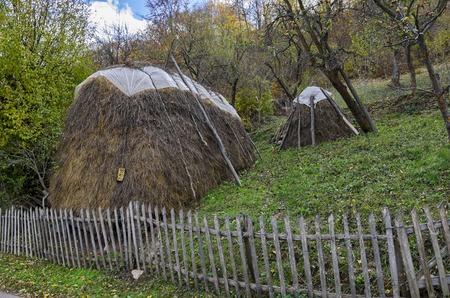 Pastoral landscape in garden with bundle of hay, Lakatnik,  Bulgaria