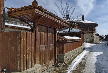 Antique cobblestone street with beauty ancient houses, town Koprivshtitsa, Bulgaria