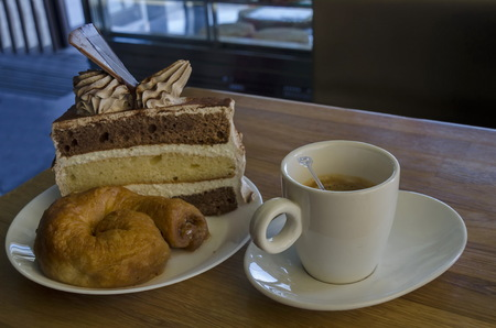 Treat for friend of cake, baklava and coffee, Sofia, Bulgaria Stock Photo