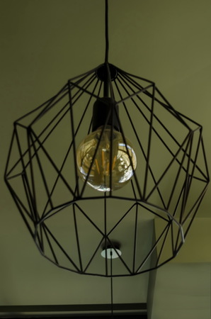 Decorative lampshade or chandelier from metal and lamp in room, Sofia, Bulgaria Stock Photo