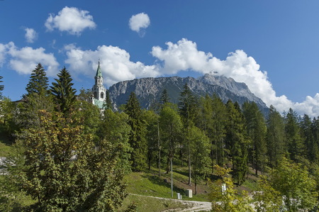 Autumnal corso Italia, the Church or Synagogue in the town center of Cortina dAmpezzo, Dolomite, Alps, Veneto, Italy,   Europe Stock Photo
