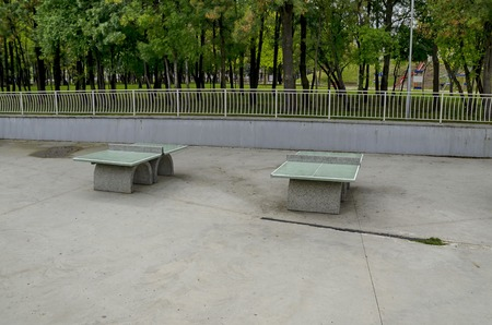 A table tennis set made from concrete material in Popular  North park,  Vrabnitsa district, Sofia, Bulgaria Stock Photo