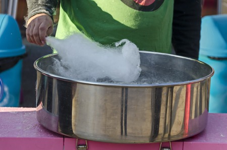 Making cotton candy in metal container at park, Sofia, Bulgaria Stock Photo