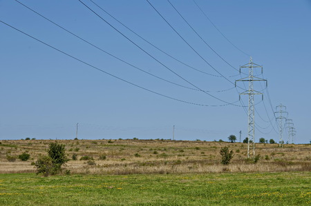 Scene with summer  meadow, mix tree and electric power transmission line near by  Sredna Gora mountain,  Ihtiman, Bulgaria 스톡 콘텐츠