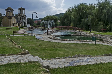 General view of public garden  in  residential district with new orthodox church, two artificial ponds, fountain and two bridges, town Delchevo, Macedonia, Europe Archivio Fotografico