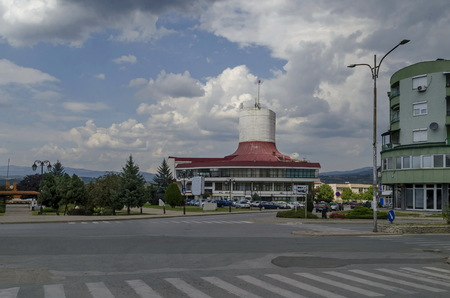 A residential district of contemporary macedonian  houses and Cultural House in  town Delchevo among Maleshevo and Osogovo mountains, Macedonia, Europe