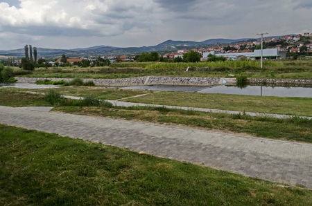 Landscape of Residential district and river valley Bregalnica with place for relax and trees, town Delchevo among Maleshevo and Osogovo mountains, Macedonia, Europe Archivio Fotografico