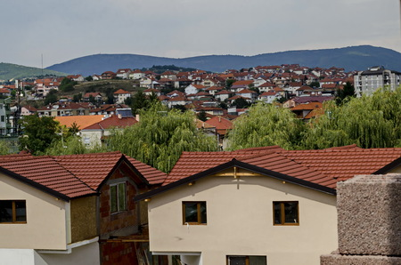 A residential district of contemporary macedonian  houses in  town Delchevo among Maleshevo and Osogovo mountains, Macedonia, Europe