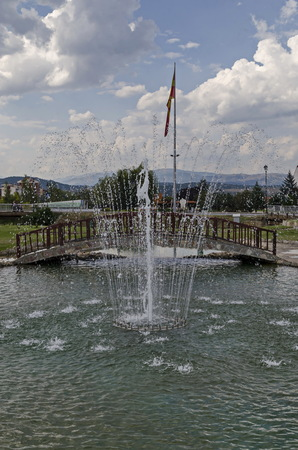 View of artificial pond and fountain close up with beauty drops, town Delchevo among Maleshevo and Osogovo mountains, Macedonia, Europe