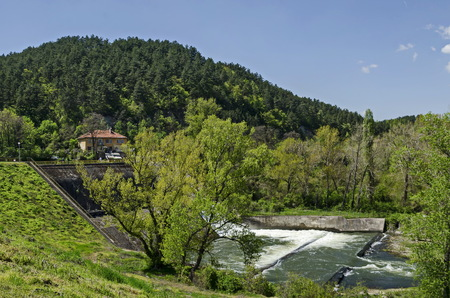 Springtime view of spillway in the dam of resort village Pancharevo, Sofia, Bulgaria