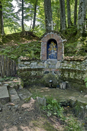 Monument of burned six monks in invasion and in the place springs healing water, Klisura Monastery St. Cyril and St. Methodius, founded in the 12th century, Balkan mountain, by the river Vrerestitsa, under Todorini dolkie peak, Varshets, Bulgaria, Europe